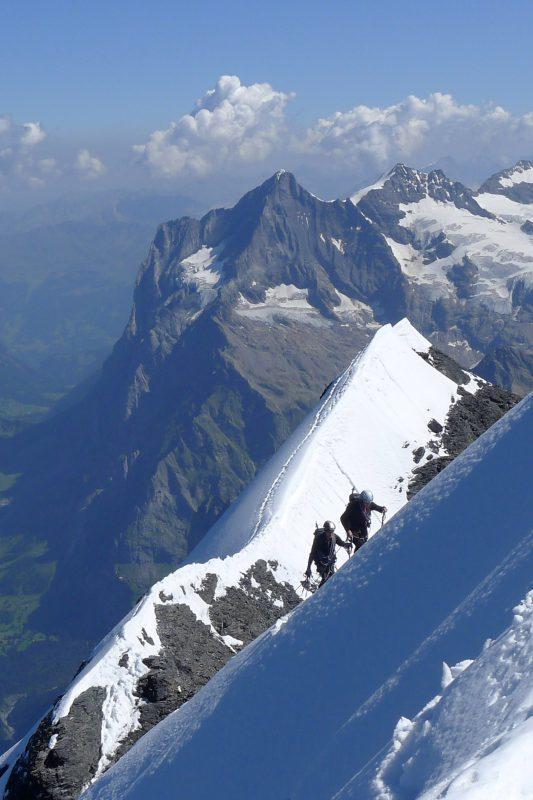 Climbing on the Mitteliggi Ridge fo the Eiger in Switzerland