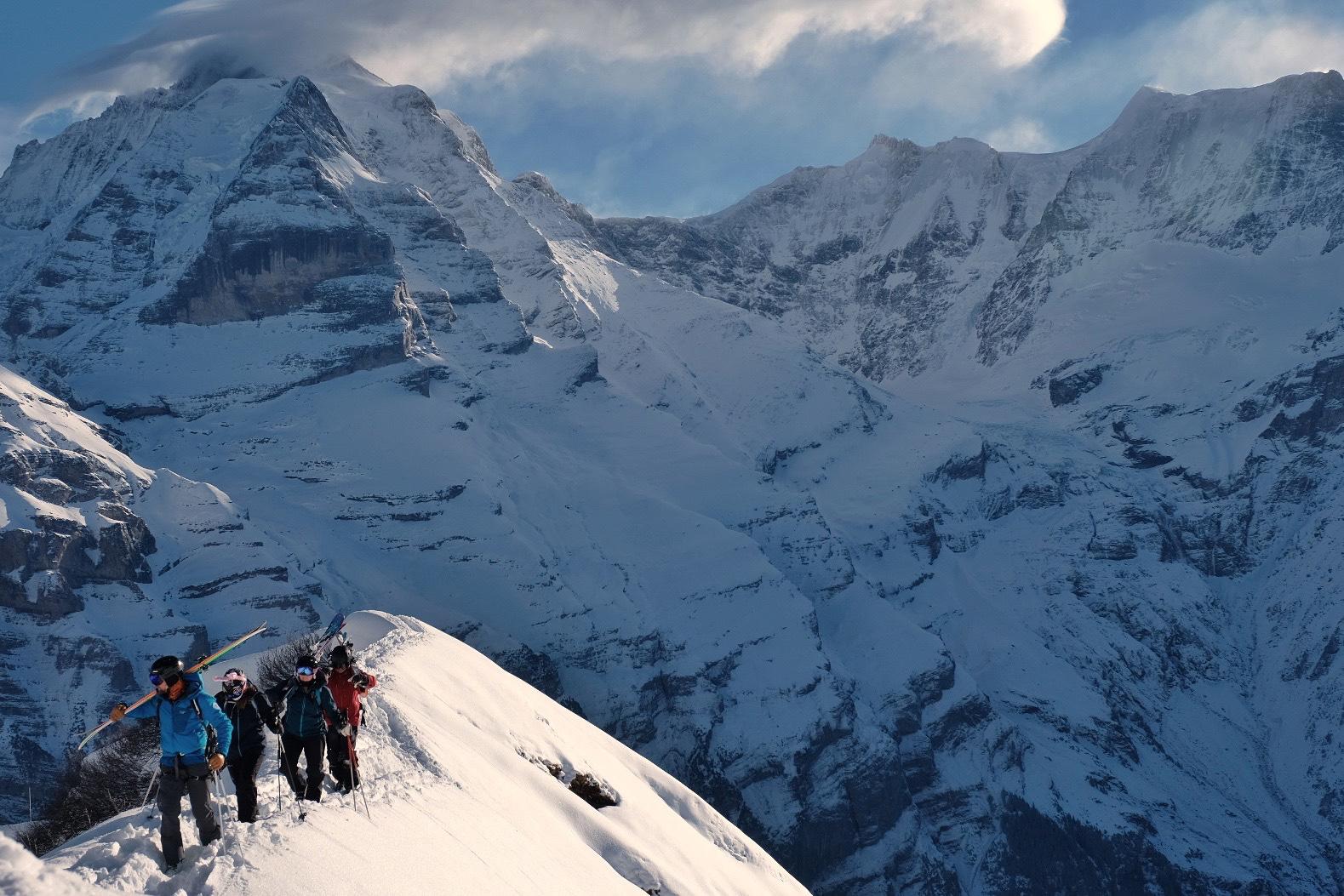 Skiers climbing a ridge above Murren, Switzerland