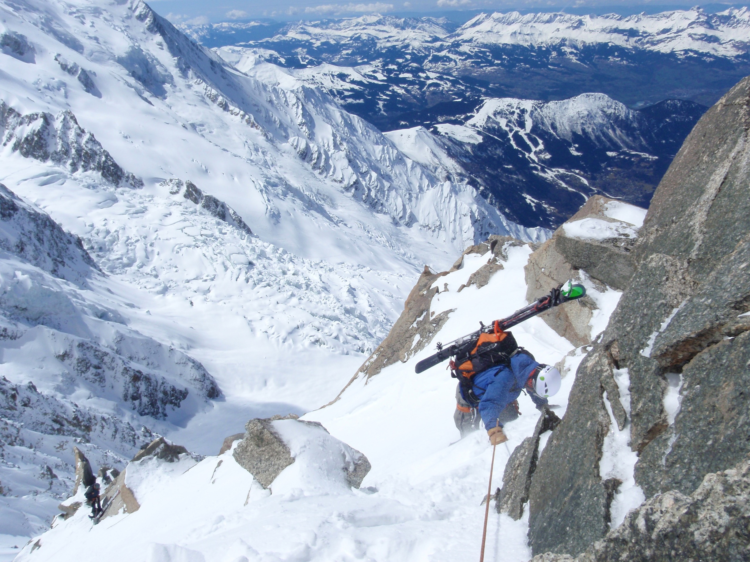 Ski mountaineering in the Mont Blanc Massif, rappeling into the Cosmiques Couloir